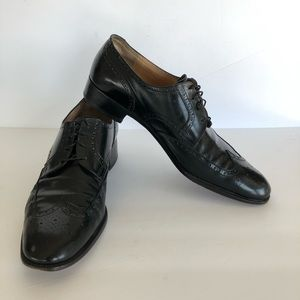 SALVATORE FERRAGAMO • black wingtip Oxford shoes
